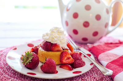 Invitation to the Train for Rewards blog party. Photo shows strawberry shortcake and tea.