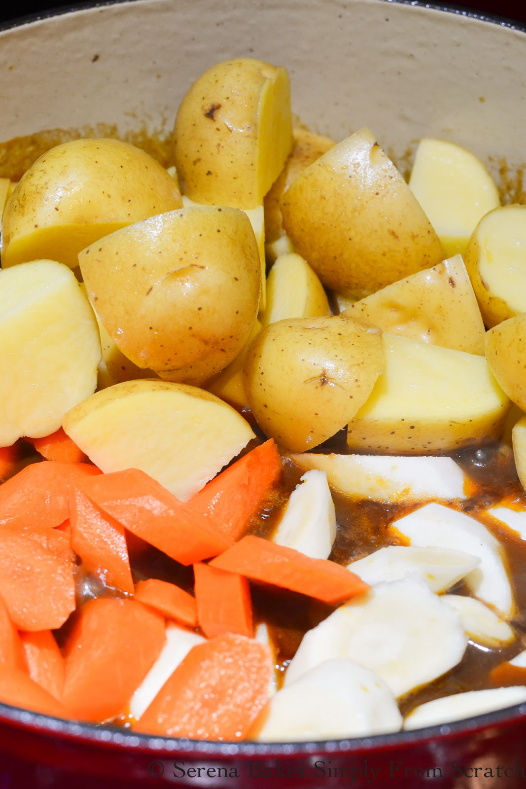 Irish Guinness Beef Stew recipe with a hearty gravy, yukon gold potatoes, carrots, and parsnips.