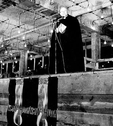 Cardinal Karol Woytła, ca. Oct. 28, 1972, speaking at Nova Huta cathedral while under construction. Three years later, Living Sound sang on this very stage, still under construction by the people of Nova Huta. The town was being built by the Communists to be free of religion. Cardinal Woytła and the parishioners had other ideas. The Cardinal and his parishioners won