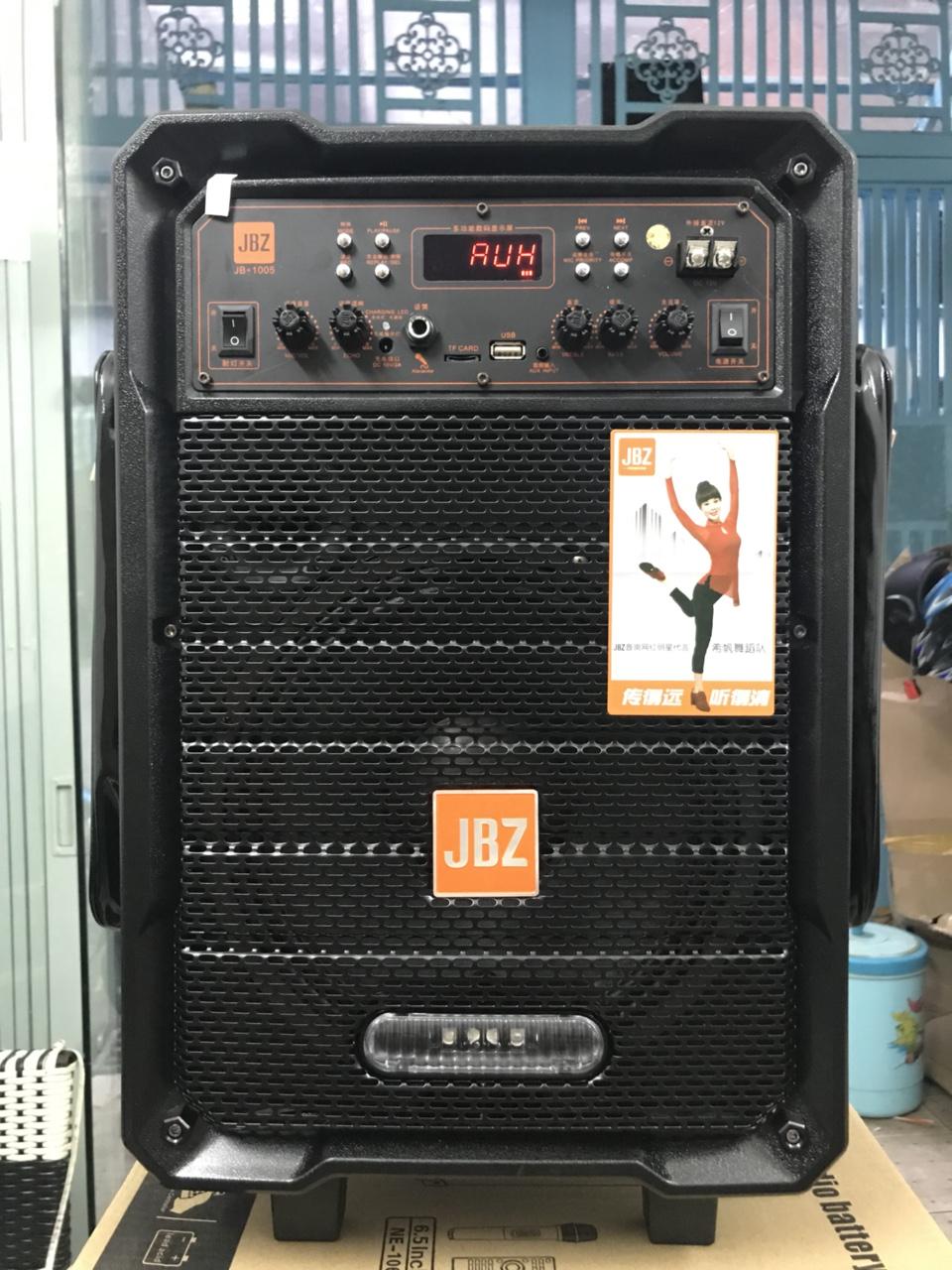 2660k - Loa bluetooth karaoke kẹo kéo JBZ NE1005 vỏ gỗ tặng 2 mic chống nhiễu giá sỉ và lẻ rẻ nhất