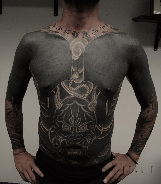Idea for a dark tattoo made from a demon that covers the chest, belly and both arms