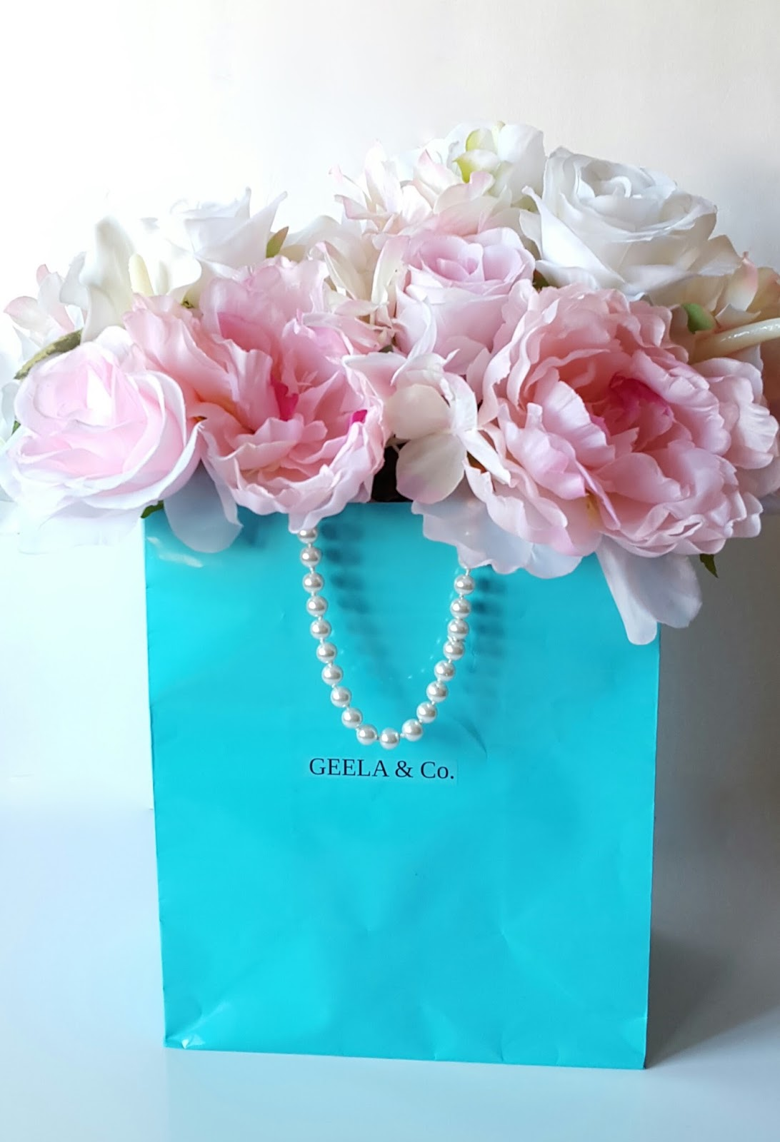 1cd79a1286 You will love this post because you will get a luxury look at a cheap cost  for your centerpieces. The little Tiffany blue bag is cute and every girl  loves ...