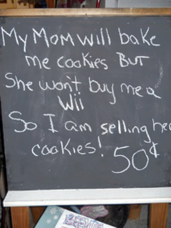 Chalkboard sign selling Mom's cookies