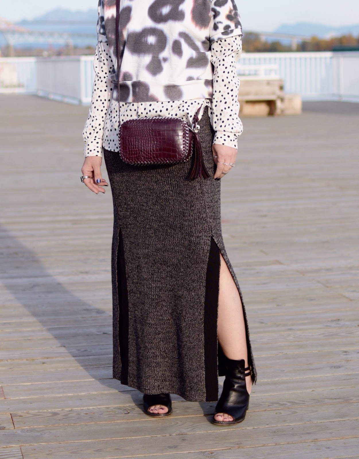 Monika Faulkner outfit inspiration - polka-dot blouse, short-sleeve sweatshirt, knit maxi-skirt, cross-body bag