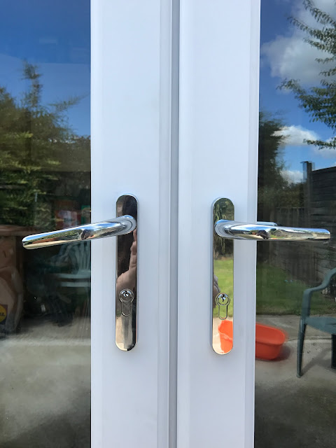 upvc french door with chrome handles