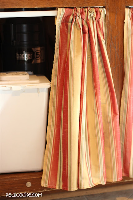 Kitchen cabinet ideas using curtains for kitchen cabinets. Pattern and Tutorial on how to make them as well. #Sewing #Pattern #Kitchen #Cabinets #RealCoake