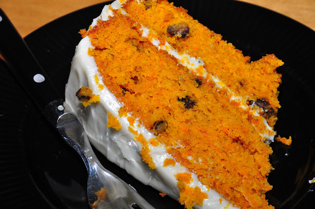 carrot cake on a plate with a fork