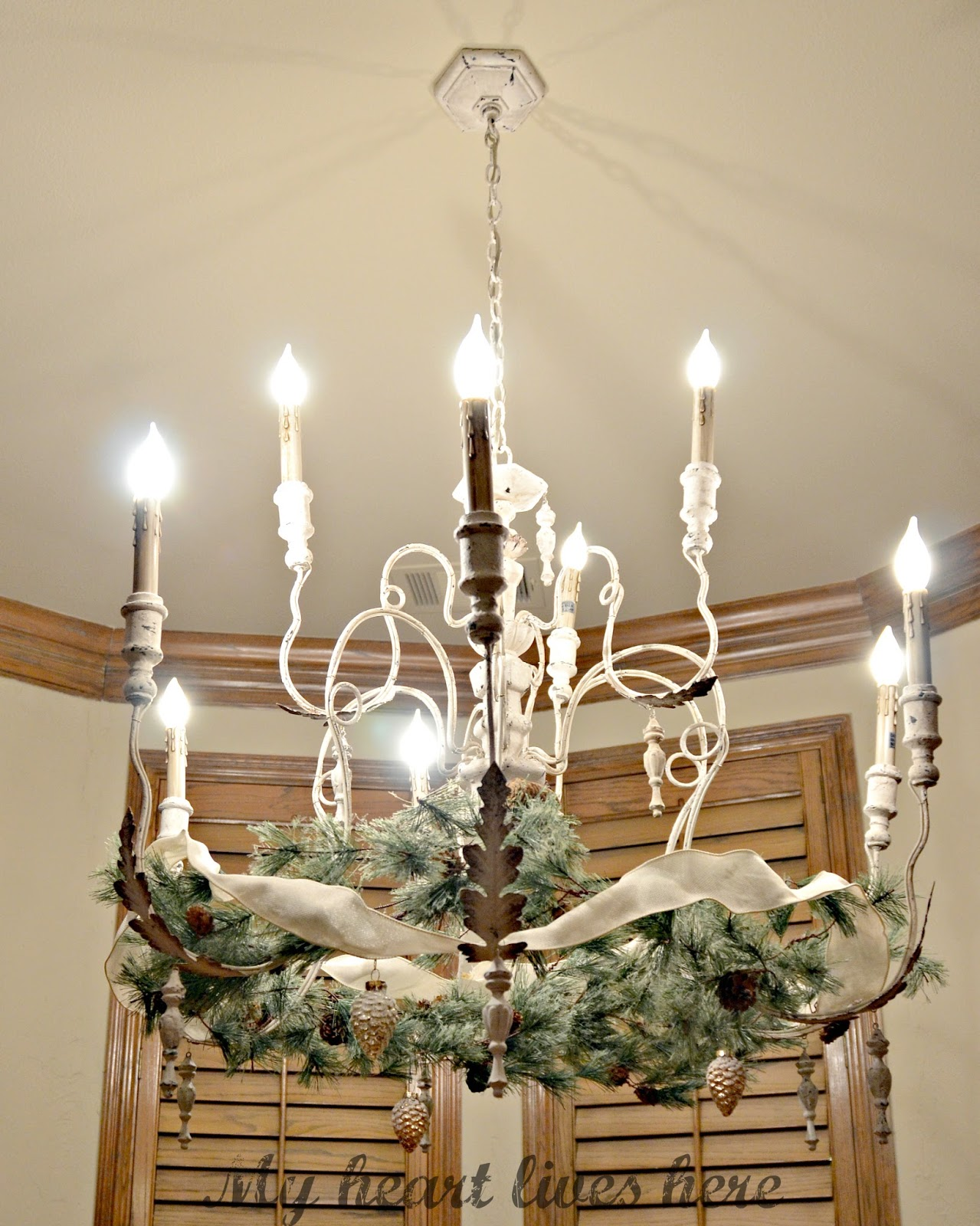 Garland on a french country chandelier my heart lives here French country chandelier