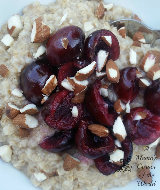 Bowl of Oatmeal with sliced cherries and slivered almond pieces