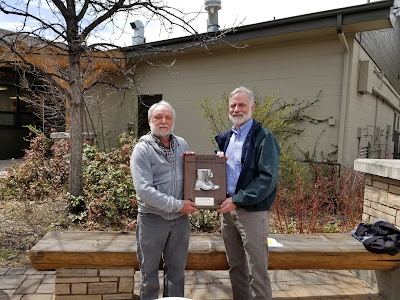 Pete Barry accepting award from Colorado State Forester Mike Lester)