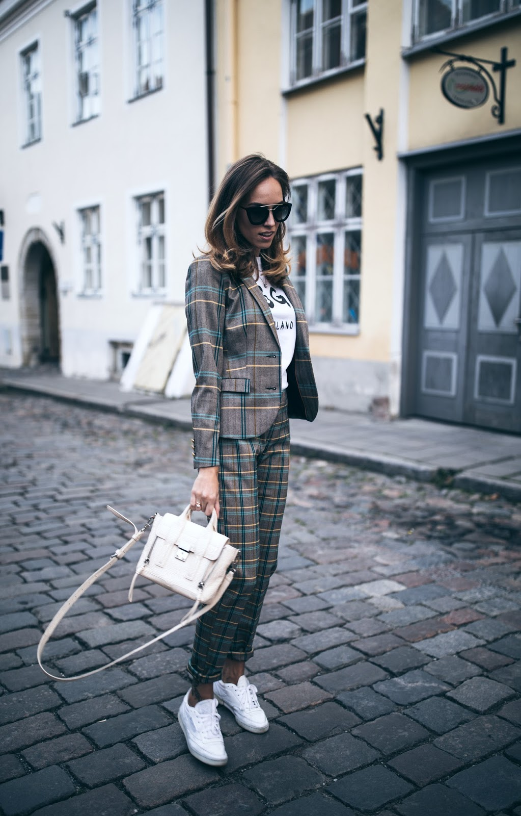 checked suit sneakers street style