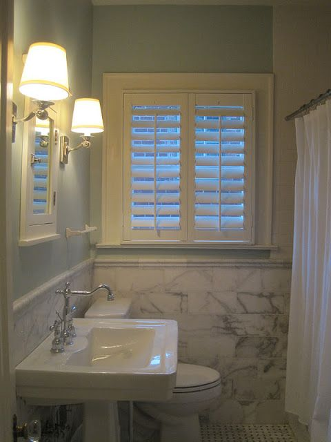 Beautiful bathroom with white plantation shutters