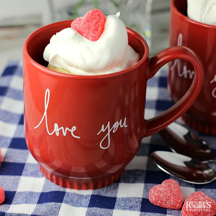 Vanilla Cake in a Mug (for Two) with whipped topping and a gummy heart in a red mug
