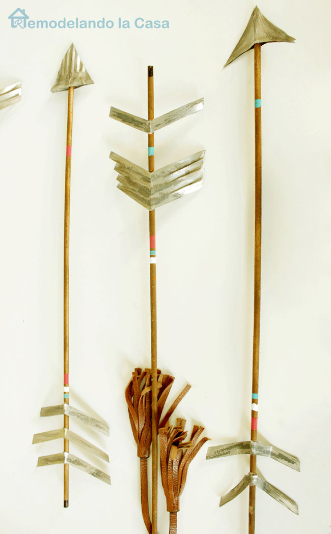 Arrows with metal heads and fletching for home decor.