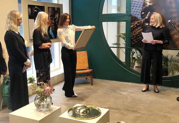 Crown Princess Mary wears Valentino Rockstud patent leather pumps. Photographer Signe Vilstrup portrait exhibition at Yume in Copenhagen