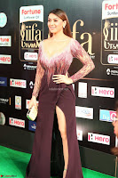 Hansika Motwani in Glittering Deep Neck Transparent Leg Split Purple Gown at IIFA Utsavam Awards 46.JPG