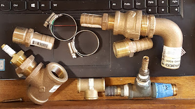 An assortment of bulky bronze fittings.