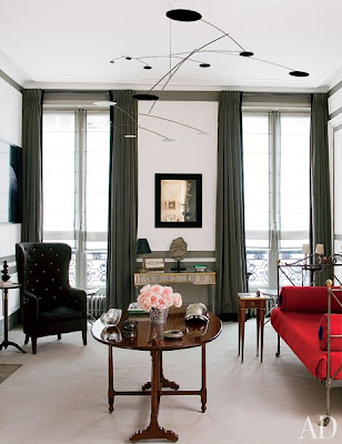 tino zervudachi's paris home living room with iron daybed with red upholster
