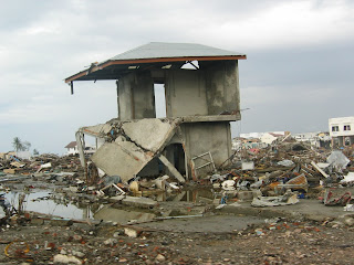 Photo of a home destroyed in a disaster.