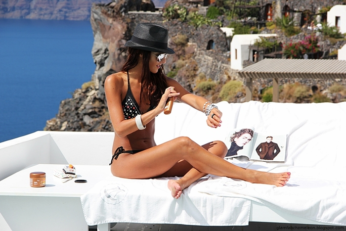 black bikini with mirrored circles and black Panama hat