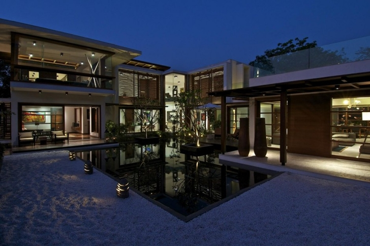 Courtyard Home by Hiren Patel Architects at night