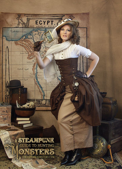 Woman wearing safari/adventurer/explorer clothing in tan khaki with corset and skirt, blouse and hat. Women's steampunk explorer adventurer costume