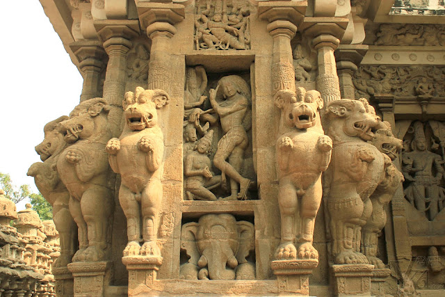Typical design of pillar with multi-directional mythical lions with panel of Shiva at the center