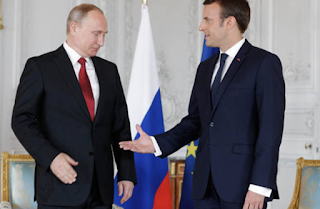 Emmanuel Macron Slams 'Fake News' From Russia In Tense Meeting With Vladimir Putin