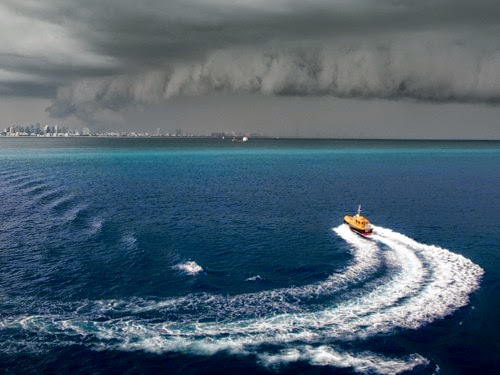 8.) Looks like it's time to turn that boat around. - These Clouds Are Scary As Hell. Better Bring An Umbrella.