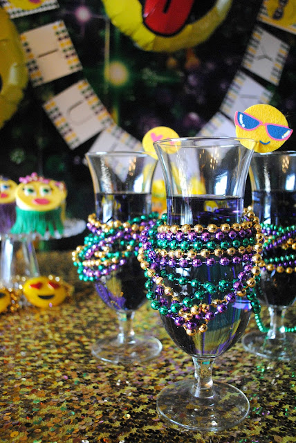 Hurricane's at an emojinal Mardi Gras party by Fizzy Party.