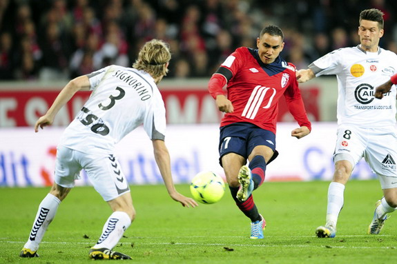 Lille player Dimitri Payet shoots to score his side's second goal against Reims