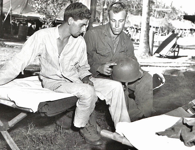 Injured US Army soldiers compare notes while at sick bay at Lipa, Batangas in 1945.  Image source:  United States National Archives.