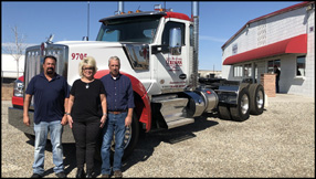 D.G. Coleman employees stand with a Kenworth W990