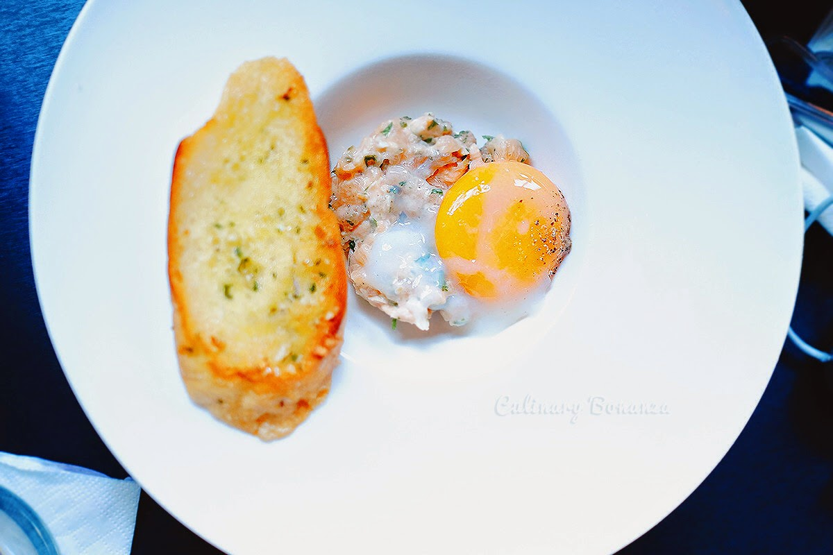 Salmon Tartare, 63°C Sous Vide Egg and Grilled Baguette.