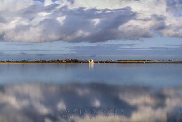 Cloud movement across the surface of Grafham Water reservoir in Cambridgeshire