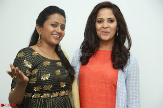 Actress Suma in Black Salwar Suit and Anusuya in orange Dress at winner movie press meet part 1 February 2017 (26).JPG