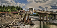 A bridge washed away by devastating floods in Alberta, Canada, in 2013. (Image Credit: Gregg Jaden via Flickr) Click to Enlarge.