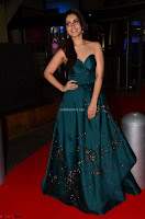 Raashi Khanna in Dark Green Sleeveless Strapless Deep neck Gown at 64th Jio Filmfare Awards South ~  Exclusive 011.JPG