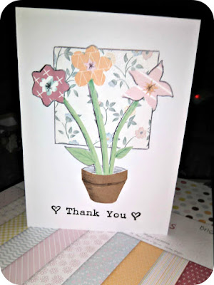 """Thank you"" stamped card with collaged flowers in a pot."