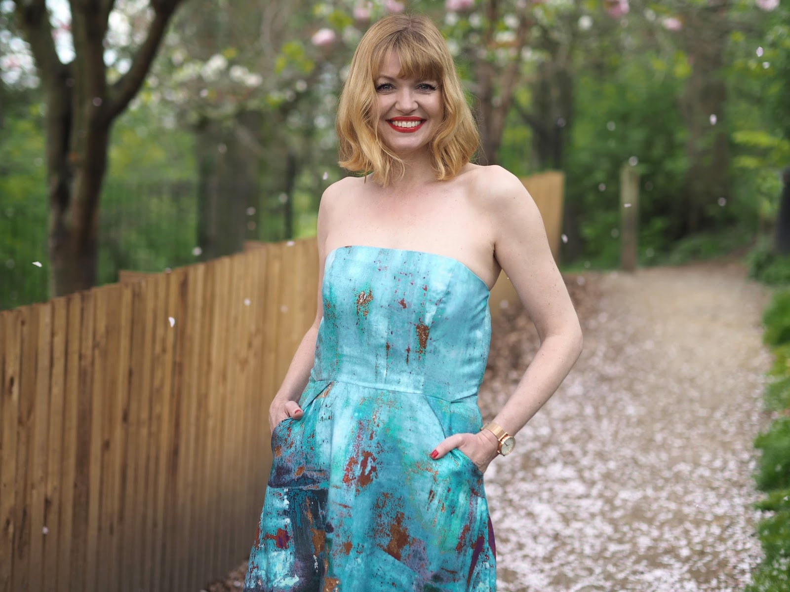 Perfect strapless dress for a spring summer wedding by Alie Street, over 40 fashion, half length