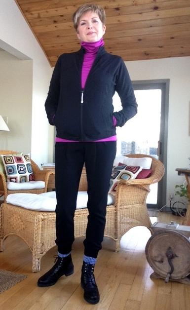 black zippered jacket from Lulu Lemon, pink Hot Chillys base layer turtleneck from Bushtakah, black joggers from Aritzia, black boots from Stuart Weitzman,