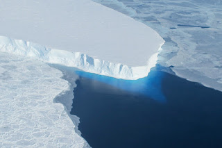 New research shows the Thwaites Glacier in Antarctica, pictured here, may be at risk of melting further inland than previously thought. (Credit: NASA) Click to Enlarge.