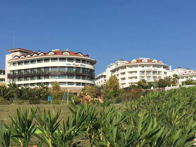 The Alba Queen hotel and the Alba Royal, both hotels are white with balconies over looking the sea