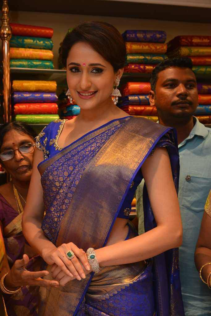 Pragya Jaiswal Hot Smiling Hip In Traditional Blue Saree At Store Launch