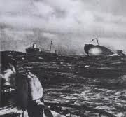 WW2 Battle of Atlantic - German U-boat torpedoed allied vessel on the right (sinking)