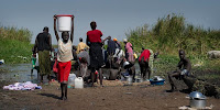 Displaced people collecting water on the banks of the River Nile, Awerial County, South Sudan. (Image Credit: Geoff Pugh/Oxfam East Africa via Flickr) Click to Enlarge.