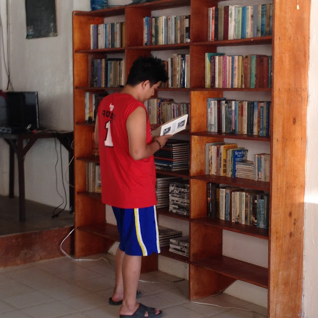 Nathaniel checking the book collection at Virgin Beach Resort