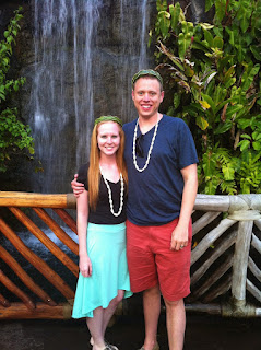 Picture of the Morgans standing in front of a waterfall in the Polynesian Cultural Center