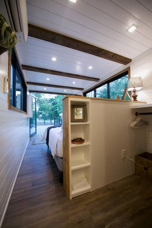09-Open-Closet-in-Bedroom-Cargohome-Sustainable-Two-Story-Tiny-Home-Shipping-Containers-www-designstack-co