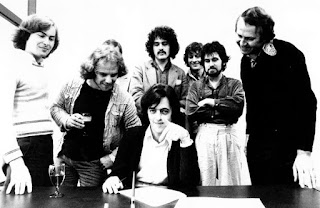 A more official and somewhat drier signing to Polydor, 1977 Left to right standing - Morton Wilson, Geoff Bowdler, Paul Jeffery, Dave Bowater, Rob Sinclair and Graham Broughton, Polygram M.D. Andrew Hagen seated.